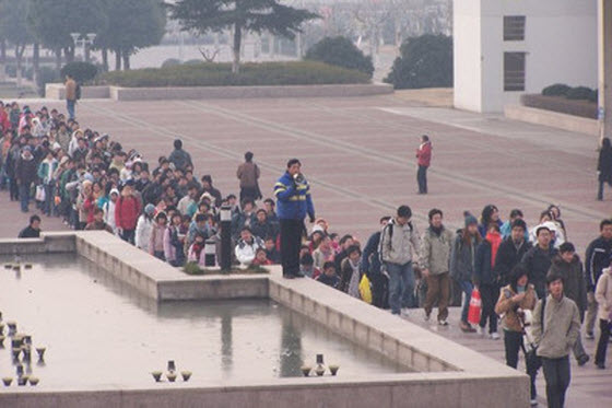 Photographs of Chinese students lining up across the entire Nanjing Normal University campus to study in the school library for end of semester final exams.