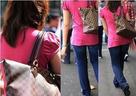 Girl in pink t-shirt with jeans carrying Louis Vuitton bag.