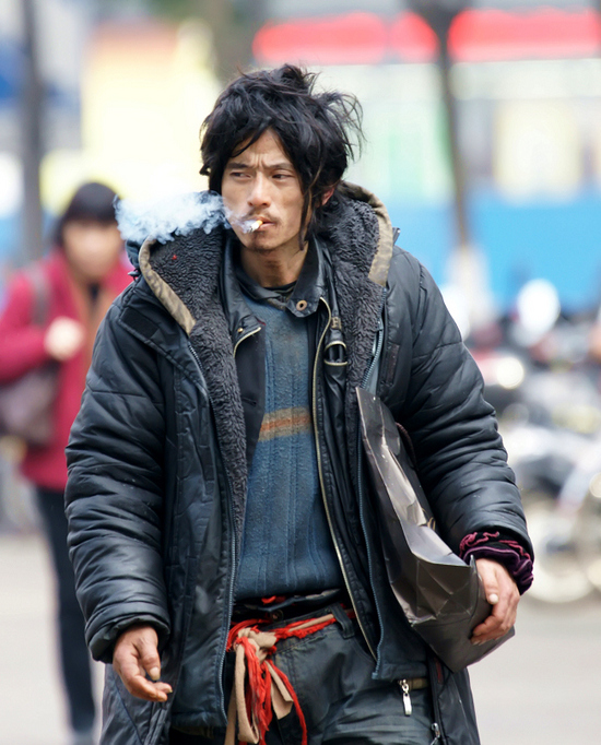 Brother Sharp, hailed by Chinese netizens as the most handsome beggar