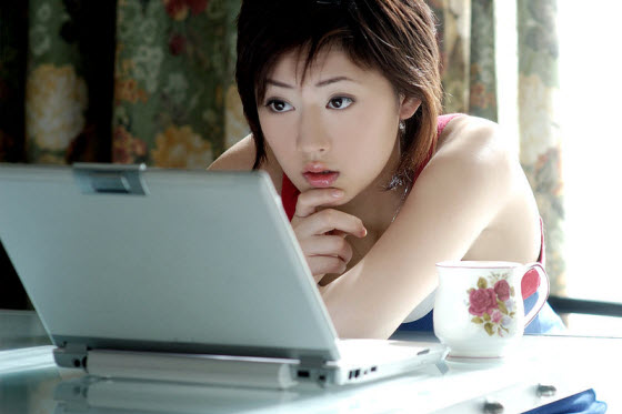 Pretty Asian Woman using laptop computer. From Mop: