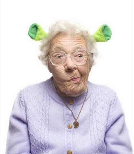 Crazy old lady wearing Shrek ears.