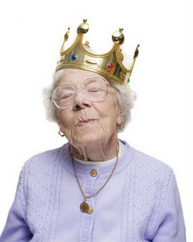 Crazy old lady wearing king's crown.