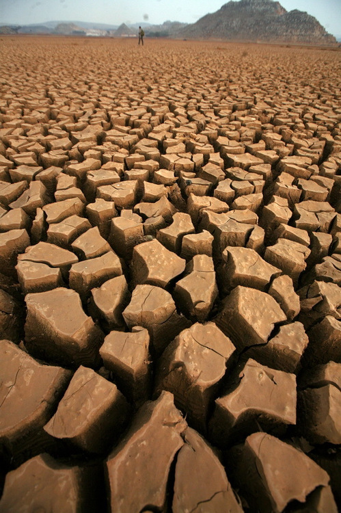 Dried and cracked mud clods are all that remain of a lake after a severe drought in Yunnan, China.