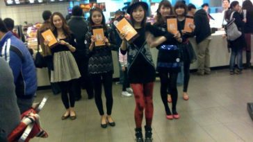 "Chinese girls suddenly dancing at a Shanghai McDonald's to promote a ""mobile phone wallet""?"