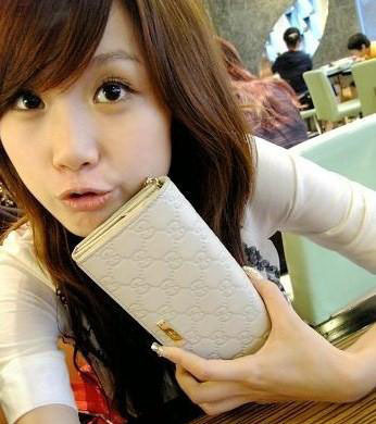 Chinese girl with her Gucci purse.