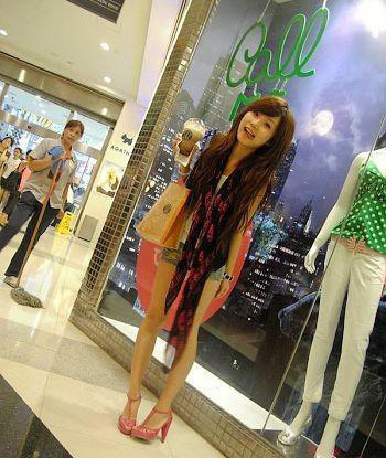 Sexy Chinese girl in a shopping mall.