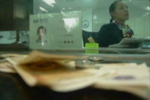 Chinese customer at a bank in Hangzhou repeatedly deposits and withdraws 1 penny.