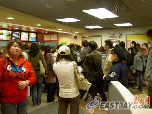 Crowd of upset Chinese customers at a KFC in Shanghai, China.