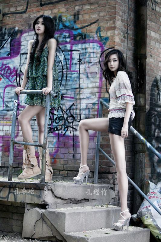 Kong Yansong and Kong Yaozhu, long-legged Chinese beauties, with graffiti background.