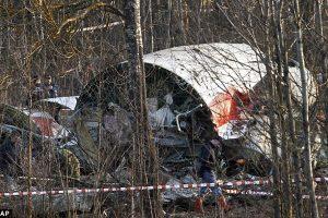 A man walks by the Tupolev Tu-145 plane wreckage.