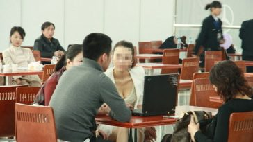 Girl with cleavage at Beijing Auto Show.