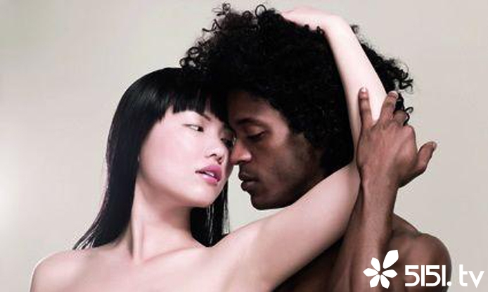 An interracial couple.