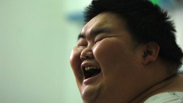 China's Fattest Man Liang Yong, laughing.