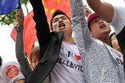 "Members of Paris' Chinese community take part in the demonstration organized by franco-chinese associations to call for ""the right to live together in security"" on June 20, 2010 in the northeastern Paris' Belleville district. A man is pictured with a t-shirt that reads in French : ""I love Belleville"". AFP PHOTO BERTRAND LANGLOIS"