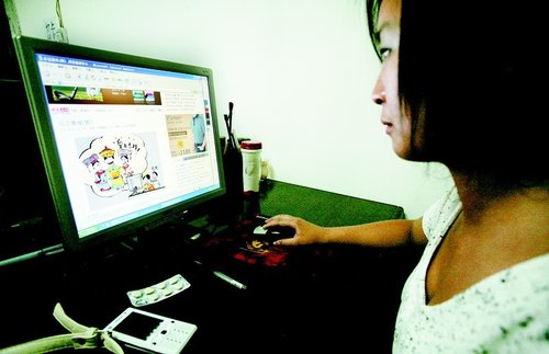 Chinese woman on computer.