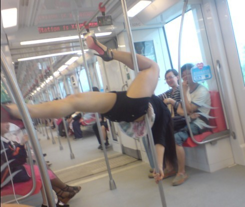 Pole-dancing Chinese girl on Nanjing Subway.