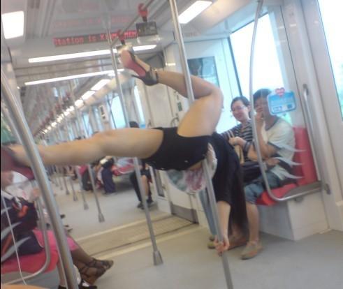 Pole-dancing Chinese girl on Nanjing Subway.