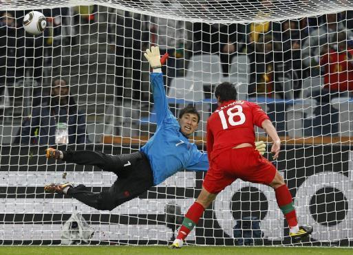 North Korean goal keeper fails to block Portugal shot.