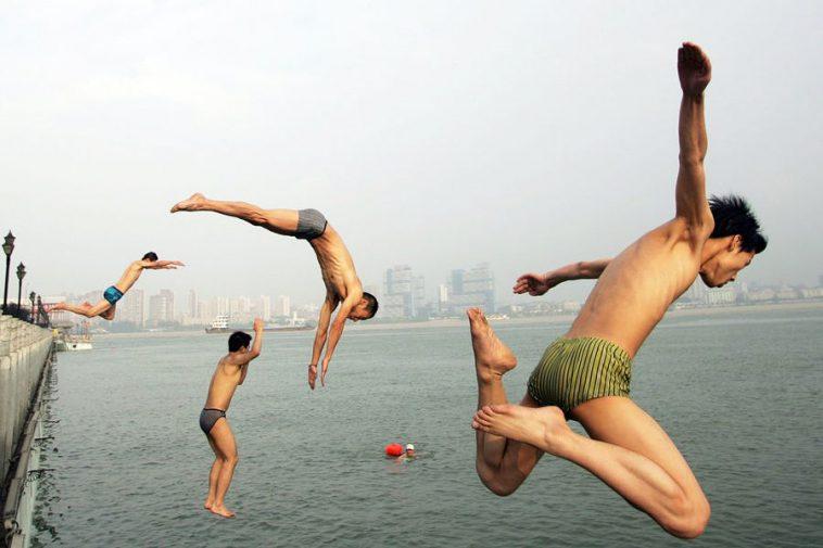 Chinese men diving in Wuhan Hankou.
