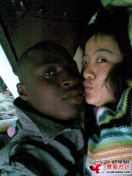 Black and Chinee couple on bed.
