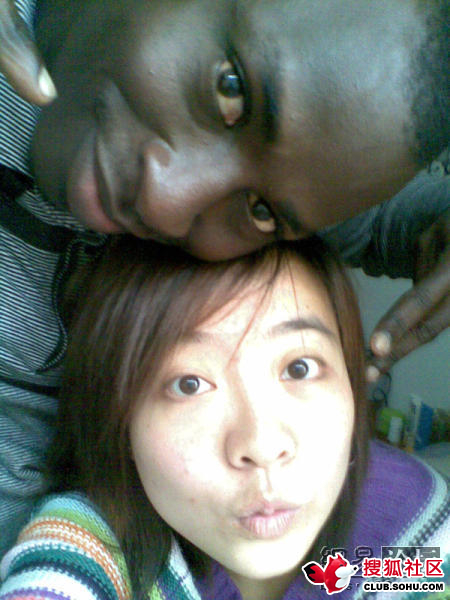 A black man and Chinese woman couple.