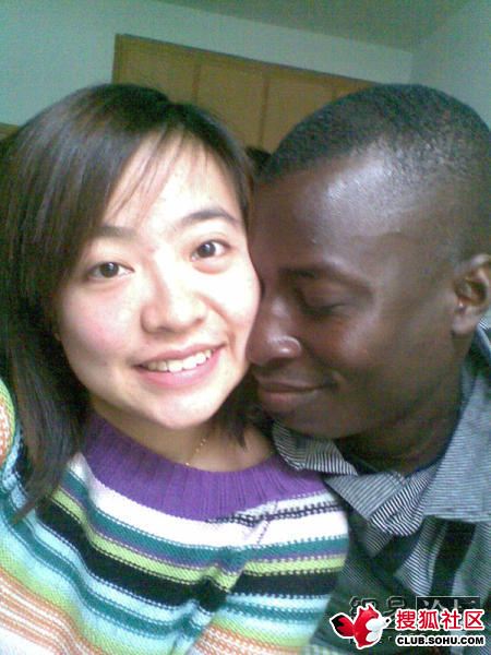 A Chinese female and black male couple.