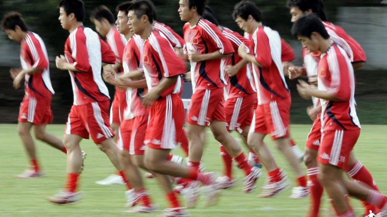 Chinese football team jogging.