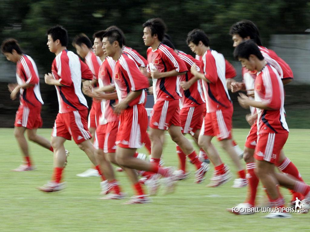 Chinese football team jogging.