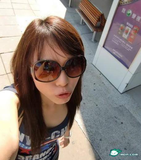 Chinese girl wearing sunglasses pouting her lips for the camera.