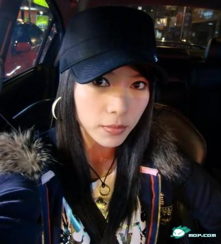 Chinese girl wearing a cap.
