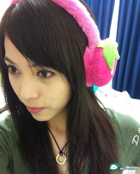 Chinese girl wearing earmuffs.
