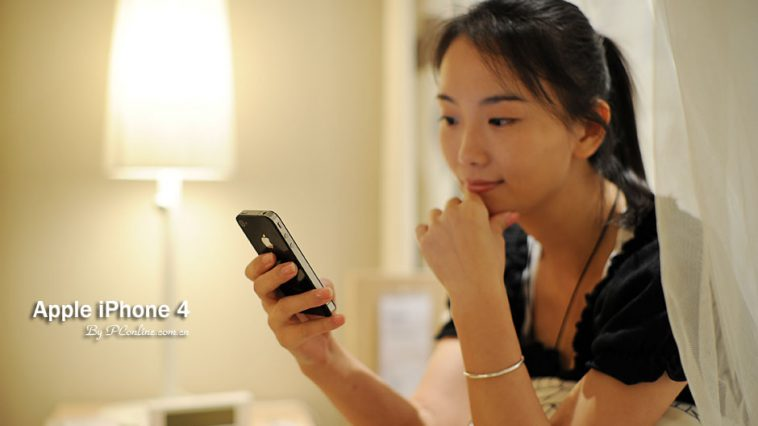Chinese girl holding iPhone 4.