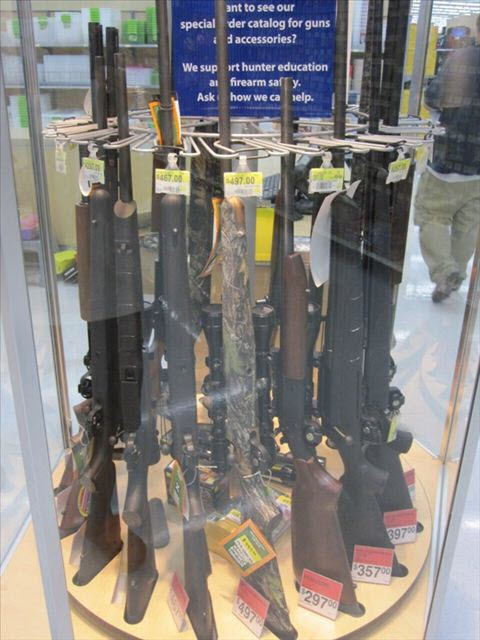 Guns on display in a glass case at a Wal-Mart in America.
