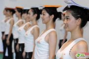 Standing up straight with books on head, ceremonial xiaojie practice for the Asia Games