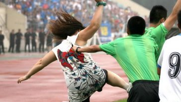 A Chinese female football fan attacks a referee at the Liaoning Normal University stadium in Dalian, China.