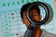 A middle school in China uses metal detectors to check if students are carrying cell phones.