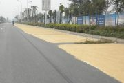 Grain drying on public roads in China.