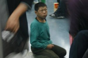 A child begger on the Beijing subway lines that does many inappropriate things to beg for money.