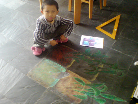 3D chalk art: planted vegetables, with son.