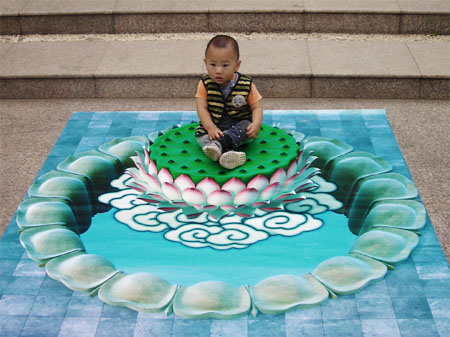 3D chalk art: child sitting on a lily pad and clouds?