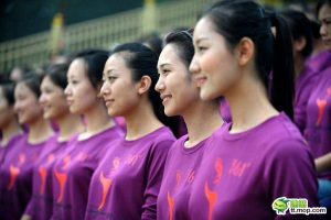 Chinese girls standing at attention, rehearsing for the Guangzhou Asian Games.