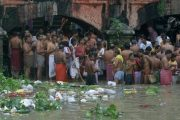 Hindu devotees perform rituals on the occasion of Mahalaya, or an auspicious day to pay homage to their ancestors, along the waste floating on the banks of River Ganges in Calcutta, India, Sunday, Sept. 28, 2008. (AP Photo/Bikas Das)