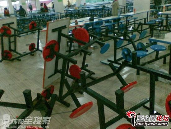 Overturned cafeteria tables and benches at a Guizhou high school cafeteria.