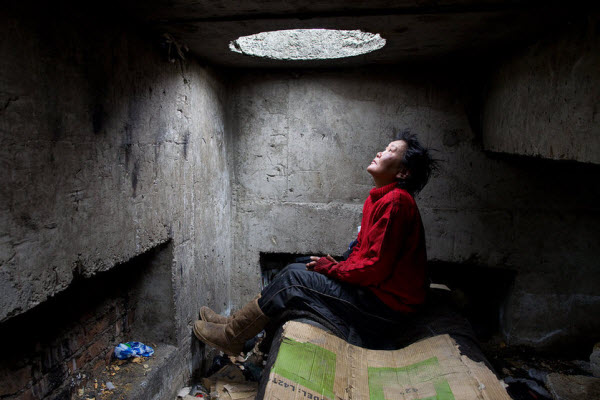 Mongolians living underground in sewers to avoid winter cold.