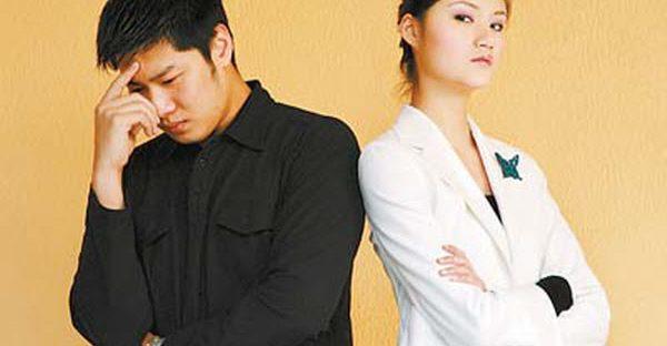 Asian man and woman upset.
