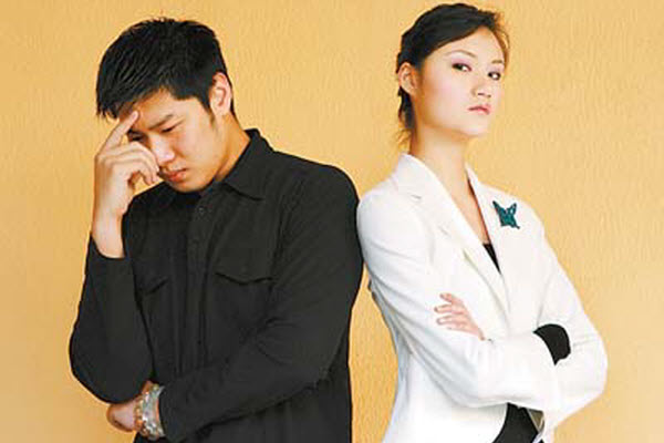 Asian man and woman upset.