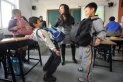 3rd grade students in Beijing, China use backpacks to experience one of the hardships of pregnancy.