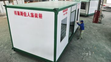 A man applies finishing touches to a container home in Chengdu.
