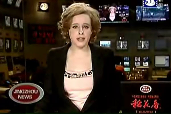 A caucasian ethnicity news anchorwoman for Jingzhou News in China.