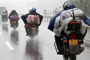 Migrant workers returning to their hometowns in motorcycle groups.